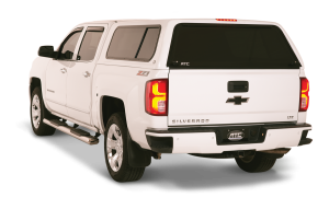 White Chevy with truck cap