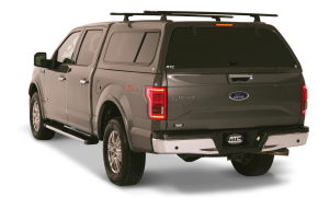 Black Ford with truck cap