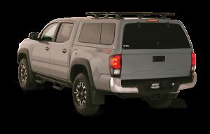 Gray Tacoma with truck cap